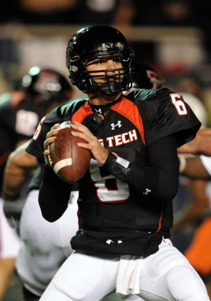 LUBBOCK, TX - NOVEMBER 08:  Quarterback Graham Harrell #6 of the Texas Tech Red Raiders drops back to pass against the Oklahoma State Cowboys at Jones AT&T Stadium on November 8, 2008 in Lubbock, Texas.  (Photo by Ronald Martinez/Getty Images)