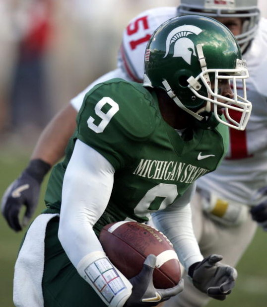 EAST LANSING, MI - OCTOBER 14:  Demond Williams #9 of the Michigan State Spartans tries to get around the tackle of Ross Homan #51 of the Ohio State Buckeys during second quarter action on October 14, 2006 at Spartan Stadium in East Lansing, Michigan. Ohi