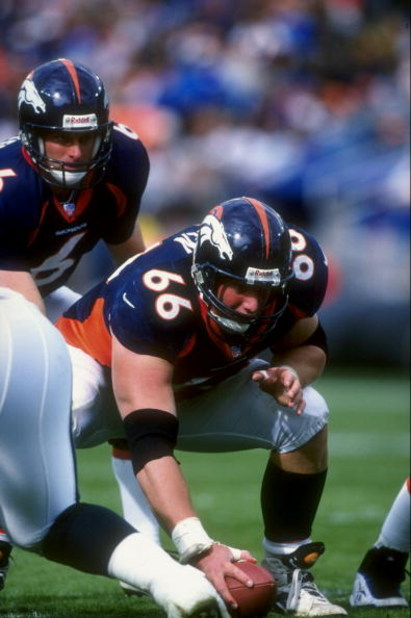 4 Oct 1998:  Center Tom Nalen #66 of the Denver Broncos in action during a game against the Philadelphia Eagles at the Mile High Stadium in Denver, Colorado. The Broncos defeated the Eagles 41-16.