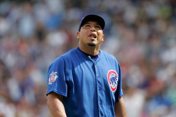 CHICAGO, IL - SEPTEMBER 19: Pitcher Carlos Zambrano #38 of the Chicago Cubs looks to the sky as he walks off the field after being taken out of the game in the 2nd inning against the St. Louis Cardinals at Wrigley Field on September 19, 2008 in Chicago, I