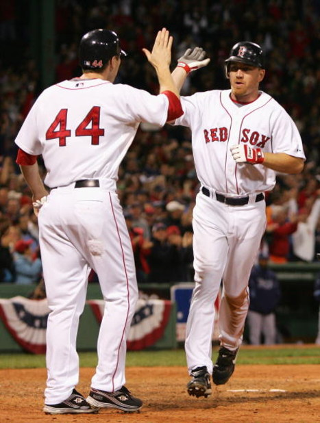 BOSTON - OCTOBER 16:  Jason Bay #44 of the Boston Red Sox congratulates teammate J.D. Drew #7  after Drew hit a 2 run home run against the Tampa Bay Rays in the eighth inning of game five of the American League Championship Series during the 2008 MLB play