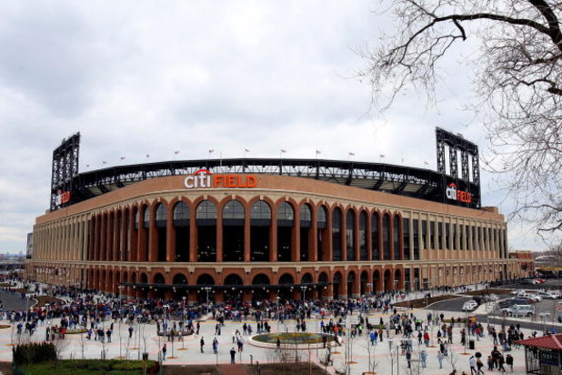 NEW YORK - APRIL 04:  Fans arrive for the exhibition game between the New York Mets and the Boston Red Sox on April 4, 2009 at Citi Field in the Flushing neighborhood of the Queens borough of New York City.  (Photo by Jim McIsaac/Getty Images)
