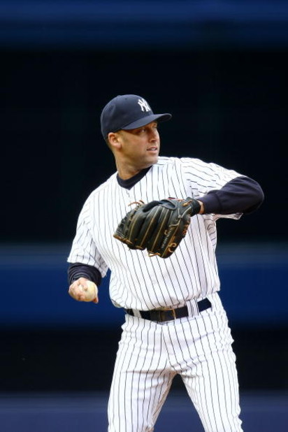 NEW YORK - APRIL 04: Derek Jeter #2 of the New York Yankees warms up against the Chicago Cubs during their game on April 4, 2009 at Yankee Stadium in the Bronx borough of New York City.  (Photo by Chris McGrath/Getty Images)