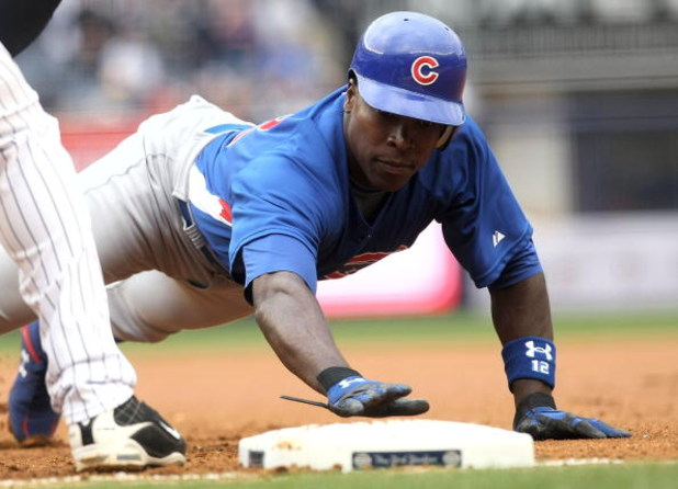 NEW YORK - APRIL 04: Alfonso Soriano #12 of the Chicago Cubs dives back into first base against the New York Yankees during their game on April 4, 2009 at Yankee Stadium in the Bronx borough of New York City.  (Photo by Nick Laham/Getty Images)
