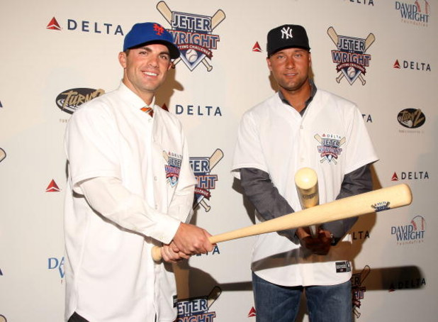 NEW YORK - APRIL 03:  David Wright of the New York Mets and Derek Jeter of the New York Yankees attend Delta's Jeter/Wright batting challenge at the Stone Rose Lounge on April 3, 2009 in New York City.  (Photo by Stephen Lovekin/Getty Images)