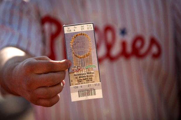 PHILADELPHIA - APRIL 05:  A Philadelphia Philliles fan shows his ticket to the Phillies game against the Atlanta Braves on April 5, 2009 at Citizens Bank Park in Philadelphia, Pennsylvania. Today's game is the opening of the 2009 major league baseball sea