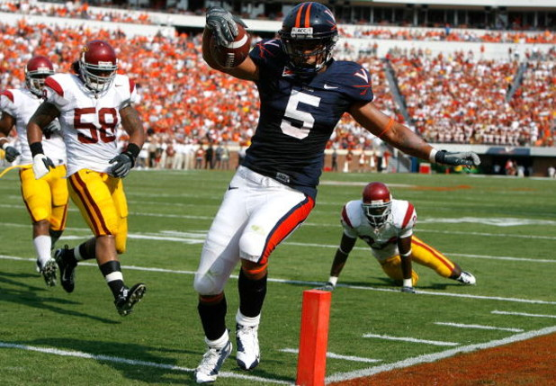 CHARLOTTESVILLE, VA - AUGUST 30:  Tailback Mikell Simpson #5 of the Virginia Cavaliers scores a touchdown against the Southern California Trojans during the game at Scott Stadium on August 30, 2008 in Charlottesville, Virginia.  (Photo by Kevin C. Cox/Get