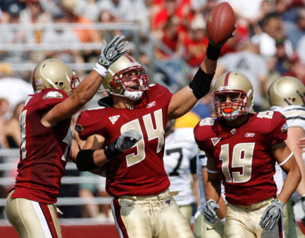 CHESTNUT HILL, MA - SEPTEMBER 22:  Linebacker Mark Herzlich of the Boston College Eagles celebrates his interception with teammates against the Army Black Knights at Alumni Stadium September 22, 2007 in Chestnut Hill, Massachusetts.  (Photo by Jim Rogash/