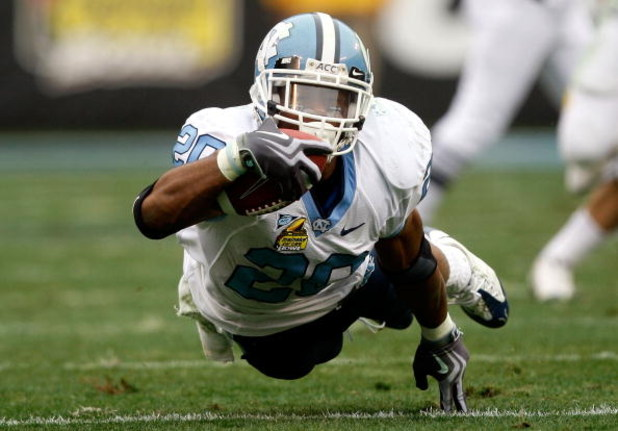 CHARLOTTE, NC - DECEMBER 27:  Shaun Draughn #20 of the North Carolina Tar Heels dives with the ball against the West Virginia Mountaineers during the Meineke Car Care Bowl on December 27, 2008 at Bank of America Stadium in Charlotte, North Carolina.  (Pho