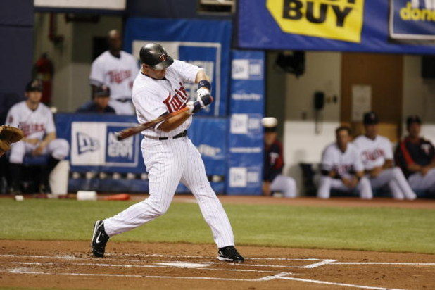 MINNEAPOLIS, MN - APRIL 2:  Michael Cuddyer #5 of the Minnesota Twins swings at a pitch against the Baltimore Orioles during the Opening Day game on April 2, 2007 at the Metrodome in Minneapolis, Minnesota.  The Twins won 7-4.  (Photo by Scott A. Schneide