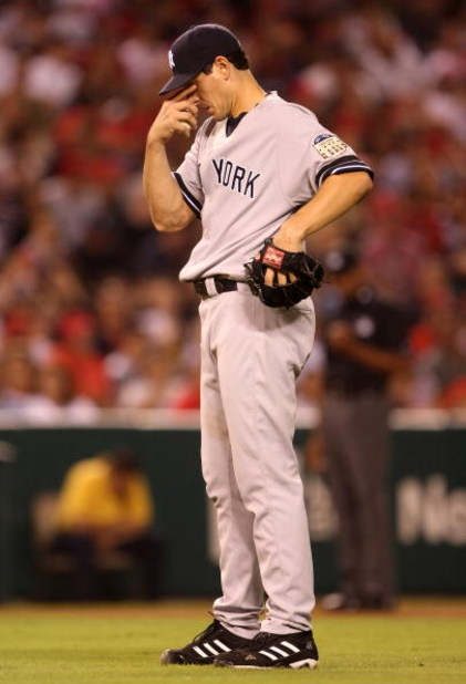 ANAHEIM, CA - SEPTEMBER 08:  Pitcher Carl Pavano #45 of the New York Yankees reacts after being called for a balk in the fifth inning against the Los Angeles Angels of Anaheim on September 8, 2008 at Angel Stadium in Anaheim, California.  (Photo by Stephe