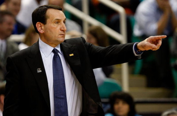 GREENSBORO, NC - MARCH 19:  Head coach Mike Krzyzewski of the Duke Blue Devils directs his team against the Binghamton Bearcats during the first round of the NCAA Division I Men's Basketball Tournament at the Greensboro Coliseum on March 19, 2009 in Green