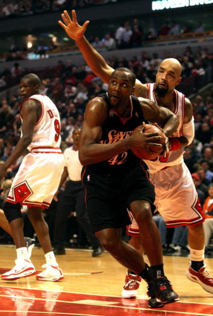 CHICAGO - DECEMBER 02:  Elton Brand #42 of the Philadelphia 76ers drives against Drew Gooden #90 of the Chicago Bulls at the United Center on December 2, 2008 in Chicago, Illinois.  NOTE TO USER: User expressly acknowledges and agrees that, by downloading