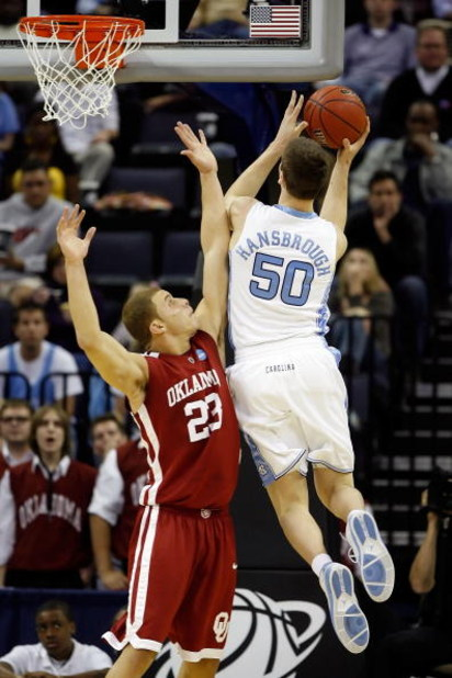 MEMPHIS, TN - MARCH 29:  Tyler Hansbrough #50 of the North Carolina Tar Heels shoots the ball over Blake Griffin #23 of the Oklahoma Sooners in the first half during the NCAA Men's Basketball Tournament South Regional Final at the FedExForum on March 29,