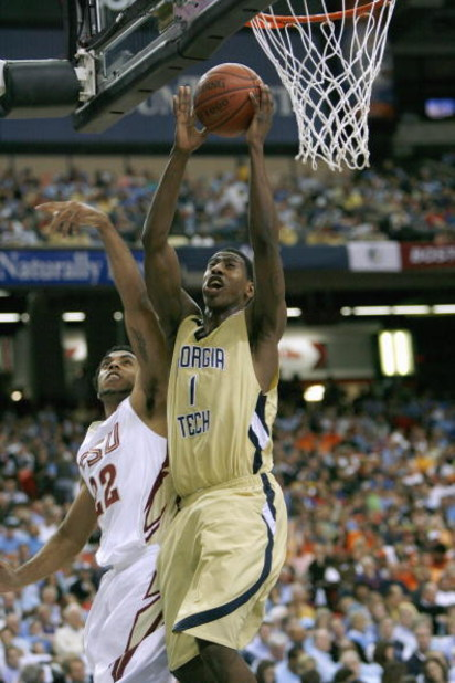 ATLANTA - MARCH 13: Iman Shumpert #1 of the Georgia Tech Yellow Jackets puts a shot up against the Florida State Seminoles during day two of the 2009 ACC Men's Basketball Tournament on March 13, 2009 at the Georgia Dome in Atlanta, Georgia.  (Photo by Kev