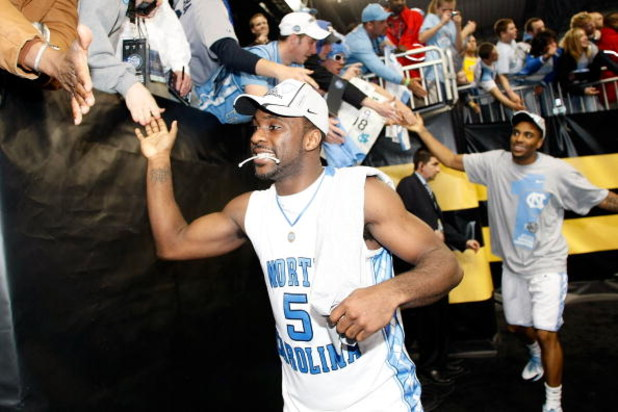 DETROIT - APRIL 06:  Ty Lawson #5 and Wayne Ellington #22 of the North Carolina Tar Heels celebrate with fans as they run off the court after the Tar Heels 89-72 win against the Michigan State Spartans during the 2009 NCAA Division I Men's Basketball Nati