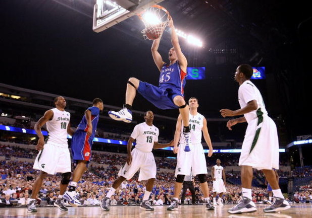 INDIANAPOLIS - MARCH 27:  Cole Aldrich #45 of the Kansas Jayhawks dunks against the Michigan State Spartans during the third round of the NCAA Division I Men's Basketball Tournament at the Lucas Oil Stadium on March 27, 2009 in Indianapolis, Indiana.  (Ph