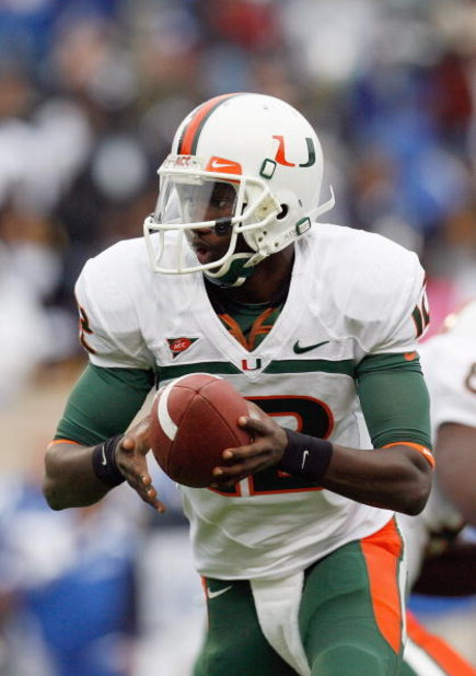 DURHAM, NC - OCTOBER 18:  Quarterback Jacory Harris #12 of the Miami Hurricanes looks to hand off the ball during the game against the Duke Blue Devils at Wallace Wade Stadium on October 18, 2008 in Durham, North Carolina.  (Photo by Kevin C. Cox/Getty Im