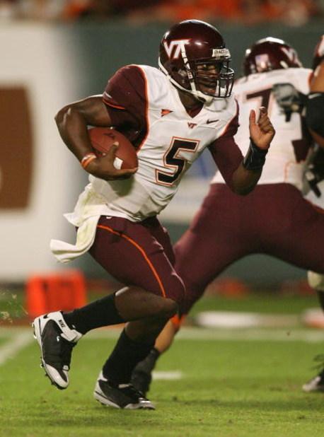 MIAMI - NOVEMBER 13:  Quarterback Tyrod Taylor #5 of the Virginia Tech Hokies runs enroute to a touchdown in the fourth quarter against the Miami Hurricanes at Dolphin Stadium on November 13, 2008 in Miami, Florida. Miami defeated the Hokies 16-14.  (Phot