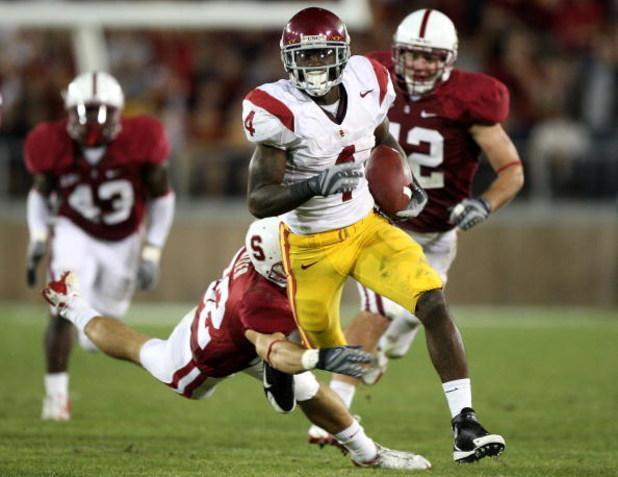 STANFORD, CA - NOVEMBER 15:  Joe McKnight #4 of USC Trojans runs against the Stanford Cardinals in the second half at Stanford Stadium on November 15, 2008 in Stanford, California.  (Photo by Jed Jacobsohn/Getty Images)