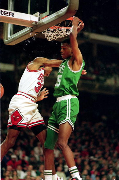 CHICAGO - DECEMBER 18:  Reggie Lewis of the Boston Celtics makes a slam dunk during the NBA game against the Chicago Bulls in the United Center on December 18, 1993 in Chicago, Illinois. NOTE TO USER: User expressly acknowledges and agrees that, by downlo