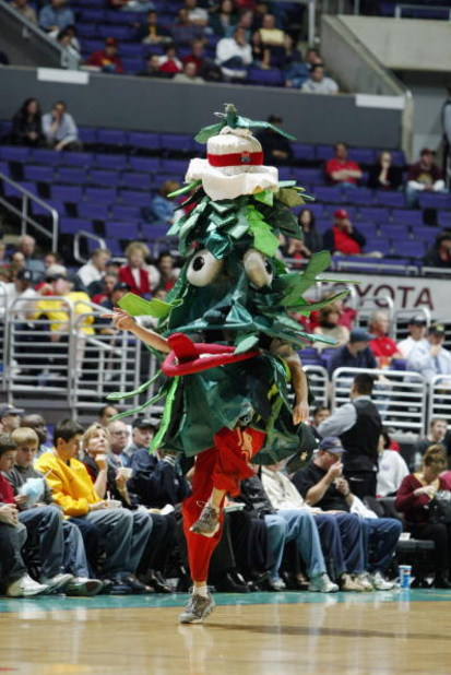 LOS ANGELES - MARCH 13:  The Stanford University Cardinal's Tree dances during an intermission in the Pac-10 Tournament against the University of Southern California Trojans at Staples Center on March 13, 2003 in Los Angeles, California.  USC defeated Sta