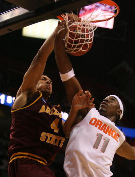 MIAMI - MARCH 22:  Forward Paul Harris #11 of the Syracuse Orange is dunked on by forward Jeff Pendergraph #4 of the Arizona State Sun Devils during the second round of the NCAA Division I Men's Basketball Tournament at the American Airlines Arena on Marc
