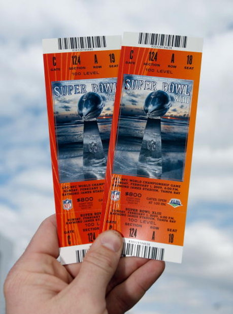 TAMPA, FL - FEBRUARY 01:  A fan holds up super bowl tickets outside the stadium prior to Super Bowl XLIII between the Arizona Cardinals and the Pittsburgh Steelers on February 1, 2009 at Raymond James Stadium in Tampa, Florida.  (Photo by Kevin C. Cox/Get