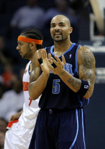 CHARLOTTE, NC - NOVEMBER 14:  Carlos Boozer #5 of the Utah Jazz celebrates after a basket in front of Jared Dudley #4 of the Charlotte Bobcats during their game at Time Warner Cable Arena on November 14, 2008 in Charlotte, North Carolina.  (Photo by Stree