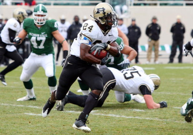 EAST LANSING, MI - NOVEMBER 08:  Kory Sheets #24 of the Purdue Boilermakers runs the ball against the Michigan State Spartans at Spartan Stadium on November 8, 2008 in East Lansing, Michigan.  (Photo by Jim McIsaac/Getty Images)
