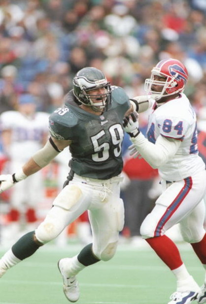 17 Nov 1996: Linebacker Mike Mamula #59 of the Philadelphia Eagles stares into the backfield as he battles with tight end Lonnie Johnson #84 of the Buffalo Bills while pursuing the football during a play in the Eagles 24-17 loss to the Bills at Veterans S