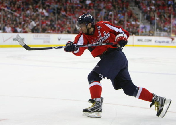 WASHINGTON - MARCH 27: Alex Ovechkin #8 of the Washington Capitals takes the shot against the Tampa Bay Lightning on March 27, 2009 at the Verizon Center in Washington, D.C. The Capitals defeated the Lightning 5-3. (Photo by Bruce Bennett/Getty Images)