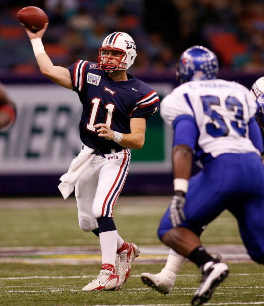 NEW ORLEANS - DECEMBER 21: Quarterback Rusty Smith #11 of the Florida Atlantic University Owls throws a pass over Clinton McDonald #53 of the Memphis University Tigers on his way to scoring a touchdown in the New Orleans Bowl on December 21, 2007 at the L