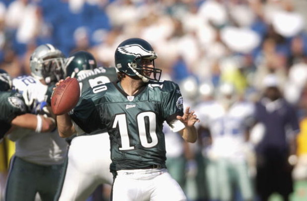 PHILADELPHIA - SEPTEMBER 22:  Quarteback Koy Detmer #10 of the Philadelphia Eagles looks to pass during the NFL game against the Dallas Cowboys on September 22, 2002 at Veterans Stadium in Philadelphia, Pennsylvania.  The Eagles won 44-13. (Photo by Ezra