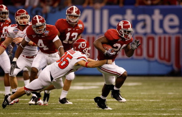 NEW ORLEANS - JANUARY 02:  Kick returner Javier Arenas #28 of the Alabama Crimson Tide runs the ball and scores a touchdown on a 73-yard punt return in the second quarter as Louie Sakoda #35 of the Utah Utes misses the tackle during the 75th Allstate Suga