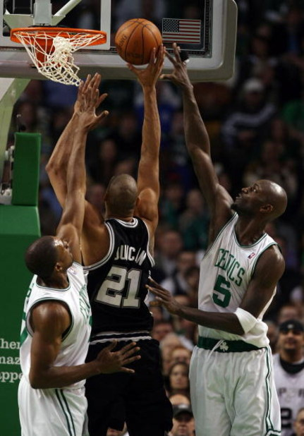 BOSTON - FEBRUARY 08:  Kevin Garnett #5 and Leon Powe #0 of the Boston Celtics try to block Tim Duncan #21 of the San Antonio Spurs on February 8, 2009 at TD Banknorth Garden in Boston, Massachusetts. NOTE TO USER: User expressly acknowledges and agrees t