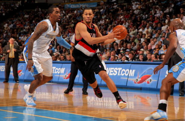 DENVER - MARCH 05:  Brandon Roy #7 of the Portland Trail Blazers drives past J.R. Smith #1 of the Denver Nuggets during NBA action at the Pepsi Center on March 5, 2009 in Denver, Colorado. The Nuggets defeated the Trail Blazers 106-90. NOTE TO USER: User