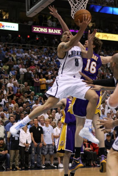SALT LAKE CITY - MAY 16:  Deron Williams #8 of the Utah Jazz goes up for a shot against Pau Gasol #16 of the Los Angeles Lakers in Game Six of the Western Conference Semifinals during the 2008 NBA Playoffs at EnergySolutions Arena on May 16, 2008 in Salt