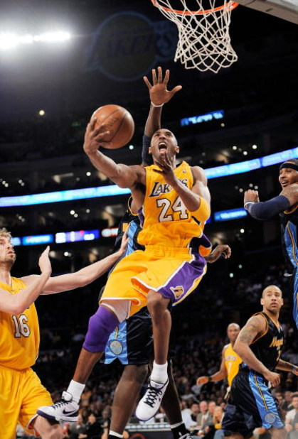 LOS ANGELES, CA - APRIL 9:  Kobe Bryant #24 of the Los Angeles Lakers scores as he drives to the basket against the Denver Nuggets at Staples Center April 9, 2009 in Los Angeles, California.  NOTE TO USER: User expressly acknowledges and agrees that, by d