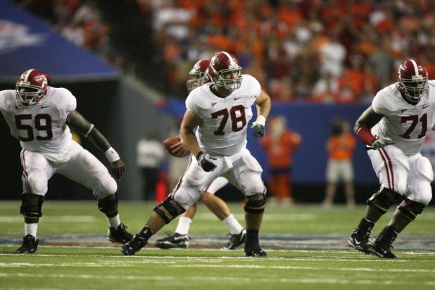 ATLANTA - AUGUST 30:  Offensive lineman Antoine Caldwell #59, Mike Johnson #78 and Andre Smith #71 of the Alabama Crimson Tide drop into pass blocking while taking on the Clemson Tigers at the Georgia Dome on August 30, 2008 in Atlanta, Georgia. Alabama d