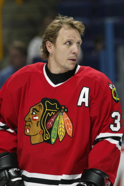 ST. LOUIS - OCTOBER 4:  Right wing Steve Thomas #32 of the Chicago Blackhawks looks on in warm-ups prior to the start of the NHL preseason game against the St. Louis Blues on October 4, 2002 at the Savvis Center in St. Louis, Missouri.  The St. Louis Blue