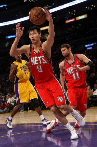 LOS ANGELES, CA - NOVEMBER 25:  Yi Jianlian #9 of the New Jersey Nets grabs a loose ball against the Los Angeles Lakers on November 25, 2008 at Staples Center in Los Angeles, California. The Lakers won 120-93.   NOTE TO USER: User expressly acknowledges a