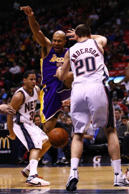 EAST RUTHERFORD, NJ - MARCH 27: Derek Fisher #2 of the Los Angeles Lakers loses the ball under pressure from Ryan Anderson #20 of the New Jersey Nets during their game on March 27, 2009 at the Izod Center in East Rutherford, New Jersey. NOTE TO USER: User