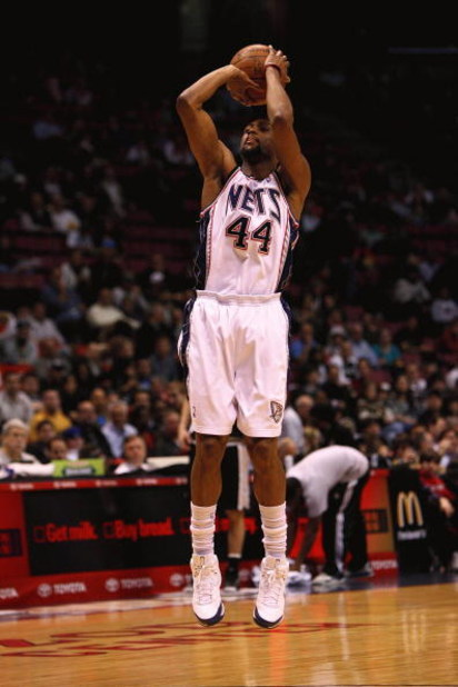 EAST RUTHERFORD, NJ - FEBRUARY 10:  Trenton Hassell #44  of the New Jersey Nets shoots against against the San Antonio Spurs during their game on February 10, 2009 at The Izod Center in East Rutherford, New Jersey.  NOTE TO USER: User expressly acknowledg