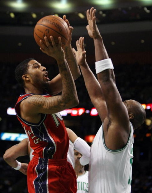 BOSTON - JANUARY 14:  Chris Douglas-Roberts #17 of the New Jersey Nets shoots over Glen Davis #11 of the Boston Celtics at TD Banknorth Garden January 14, 2009 in Boston, Massachusetts. The Celtics defeated the Nets 118-86. NOTE TO USER: User expressly ac