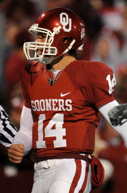 NORMAN, OK - NOVEMBER 22:  Quarterback Sam Bradford #14 of the Oklahoma Sooners celebrates a touchdown against the Texas Tech Red Raiders in the second quarter at Memorial Stadium on November 22, 2008 in Norman, Oklahoma.  (Photo by Ronald Martinez/Getty