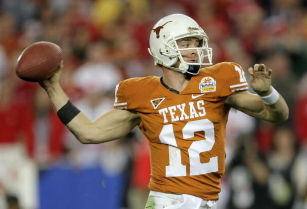 GLENDALE, AZ - JANUARY 05:  Quarterback Colt McCoy #12 of the Texas Longhorns drops back to pass during the Tostitos Fiesta Bowl Game against the Ohio State Buckeyes on January 5, 2009 at University of Phoenix Stadium in Glendale, Arizona.  (Photo by Doug