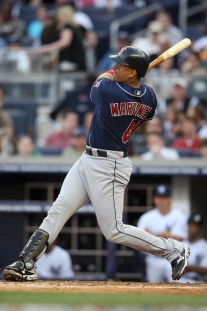 NEW YORK - APRIL 18:  Victor Martinez #41 of the Cleveland Indians hits a solo home run against the New York Yankees at Yankee Stadium on April 18, 2009 in the Bronx borough of New York City.  (Photo by Nick Laham/Getty Images)