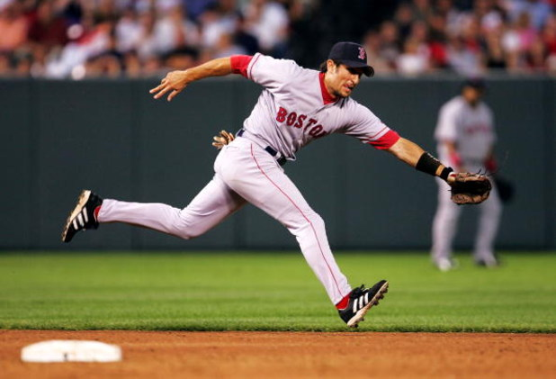 BALTIMORE - JULY 26:   Nomar Garciaparra #5 of the Boston Red Sox lunges for a ball during the 3rd inning against the Baltimore Orioles July 26, 2004 at Camden Yards in Baltimore, Maryland.  (Photo by Jamie Squire/Getty Images)