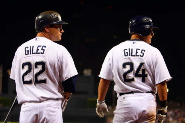 SAN DIEGO - AUGUST 16:  Brothers and teammates Marcus Giles #22 and Brian Giles #24 of the San Diego Padres prepare themselves to bat in the on deck circle against the Colorado Rockies during  their MLB Game on August 16, 2007 at Petco Park in San Diego,